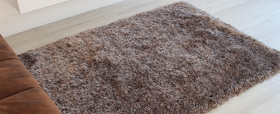 Polyester long pile rug with silky strands placed on a bedroom floor
