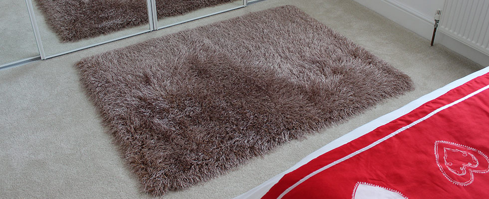 shaggy rug at the foot of a bed
