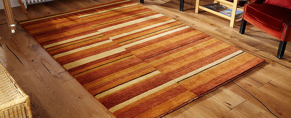large size statement rug with woollen pile on a lounge floor