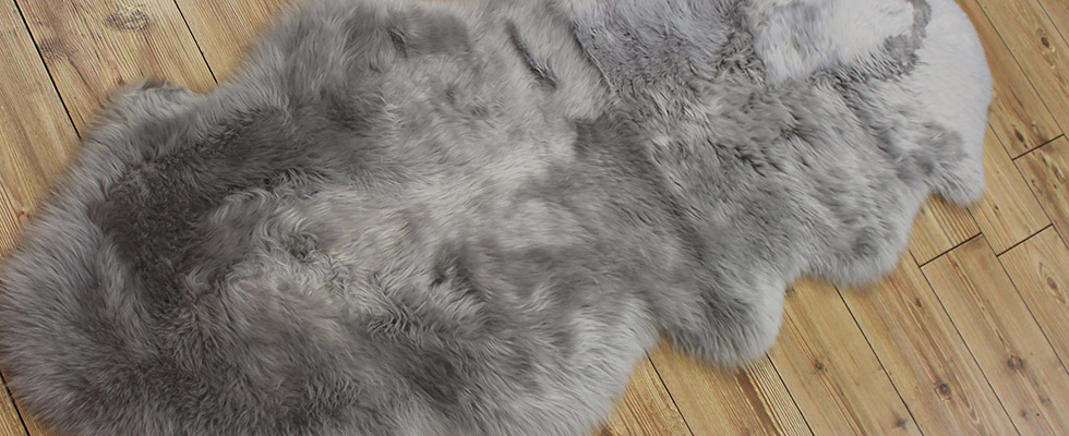 Silver colour double sheepskin on the floor