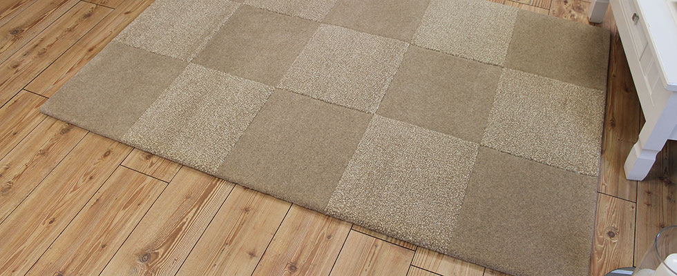 tufted rug with geometric cut and shaped pile