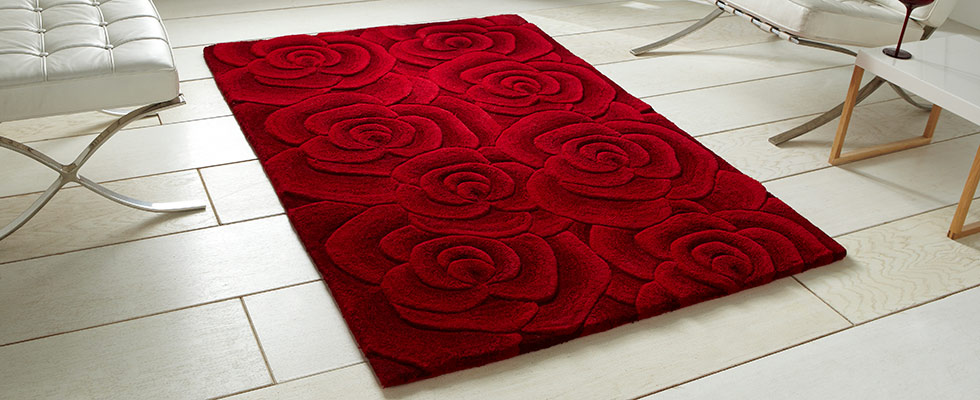 Sculptured red woollen rug with a floral design