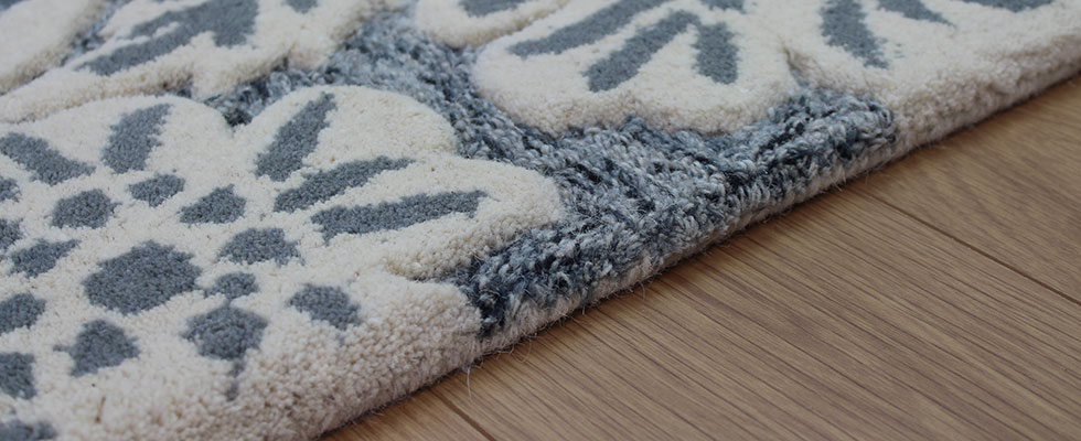 Sculptured rug with a combination cut and loop pile
