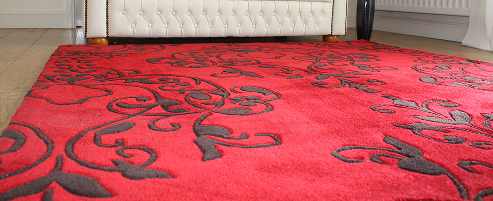 large red rug in a room setting