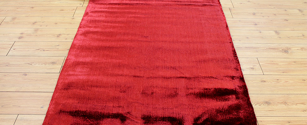 brilliant red shiny dolce rug on the floor