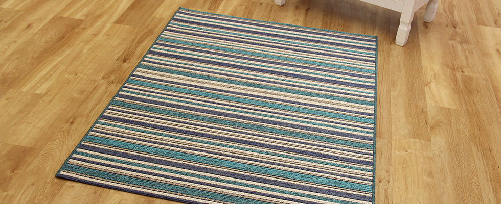 brighton rug in blue with a thin ftalwoven pile