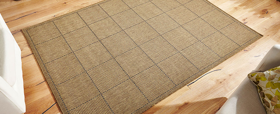 brown cheap rug with a thin pile