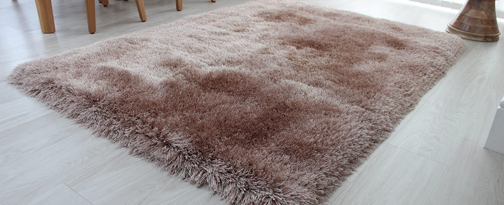 luxurious mink shaggy rug with glossy pile on the floor