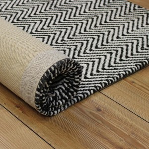 Black and white rolled rug