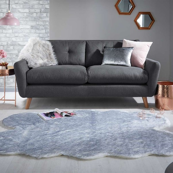 a faux fur rug placed in a scandi-style living room design