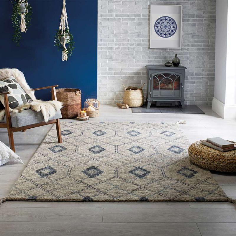 traditional grey rug placed in a scandi inspired living room