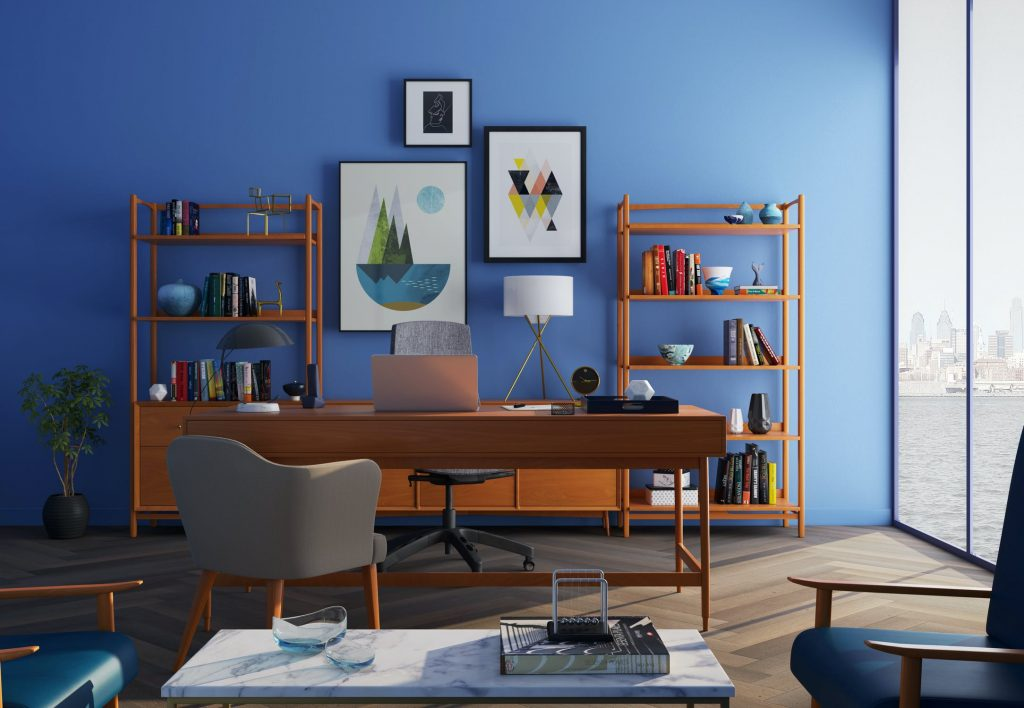 home office with blue back wall, brown furniture and large glass windows