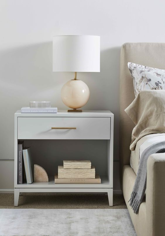 grey bedside table in bedroom with lamp placed on the table