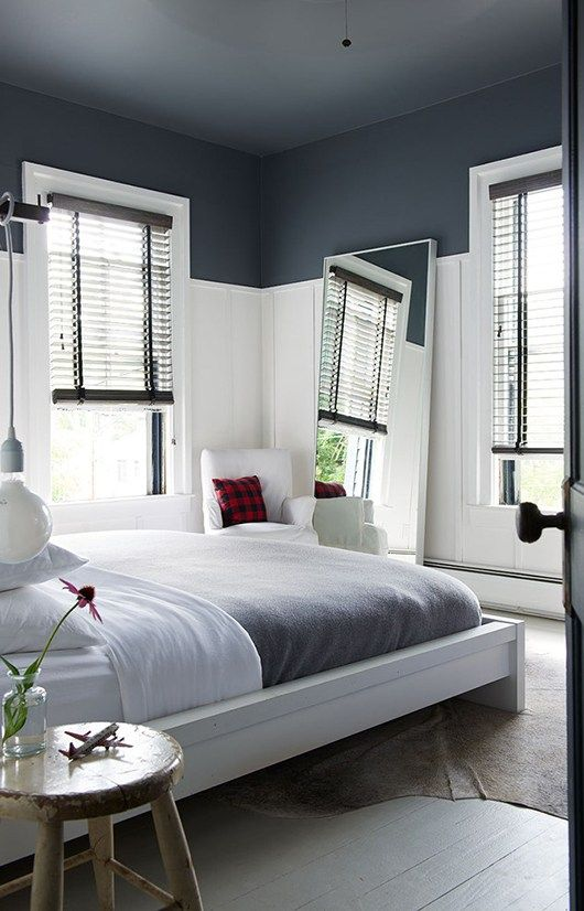 bedroom with feature design in the walls