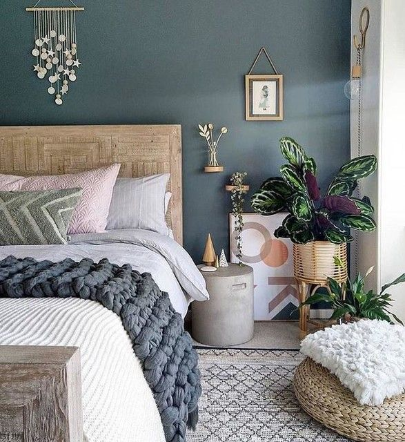 bedroom with moody colour walls and houseplants used within the space
