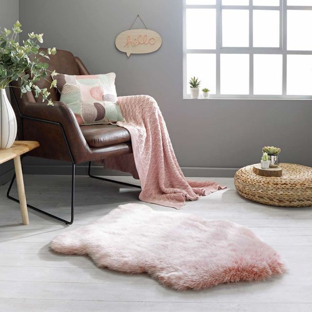 pink faux fur rug in the corner of a room