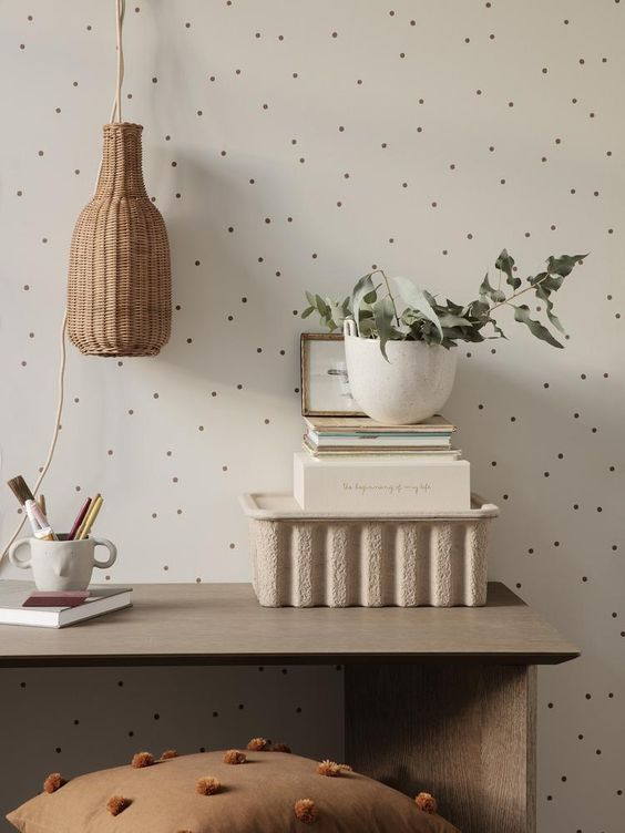 cream coloured living room wall with grey spots to add intrigue to the space