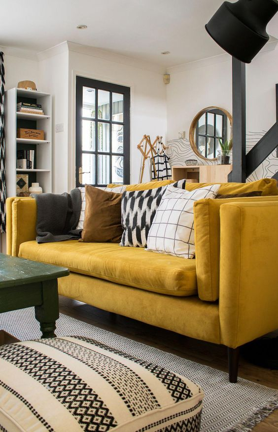 yellow sofa placed in living room with hardwood floor and a kelim rug